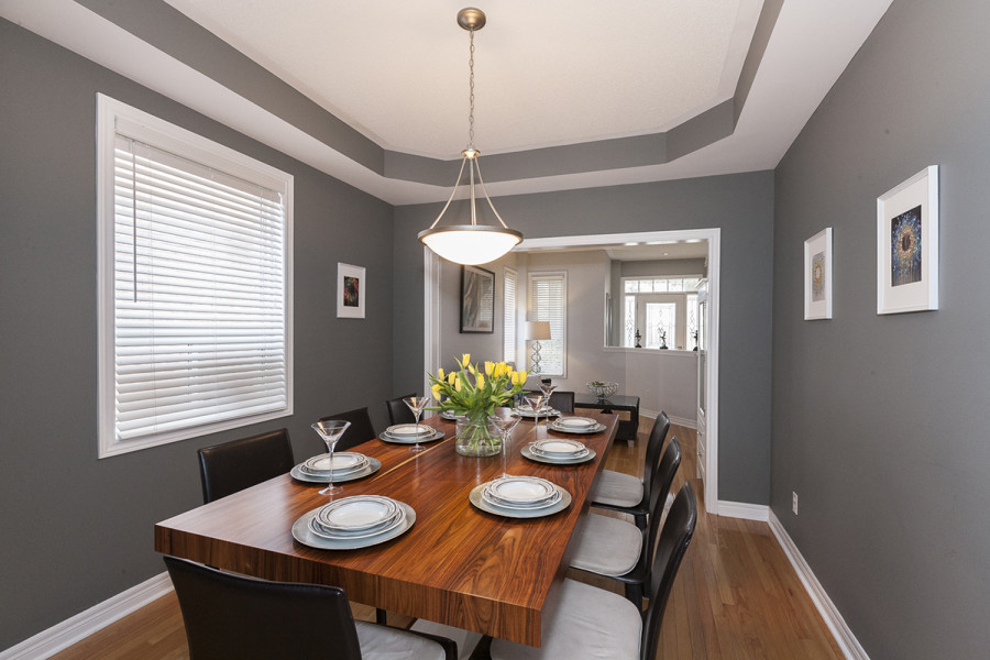 Spacious Dining room with large wooden dining table